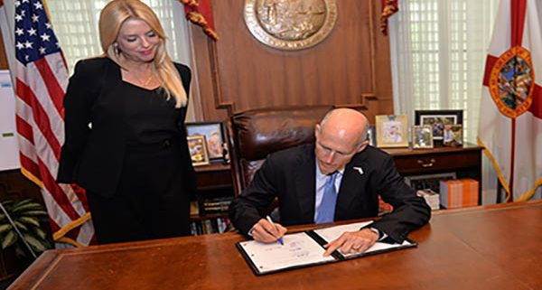 Governor Rick Scott signs Florida Life Insurance Law